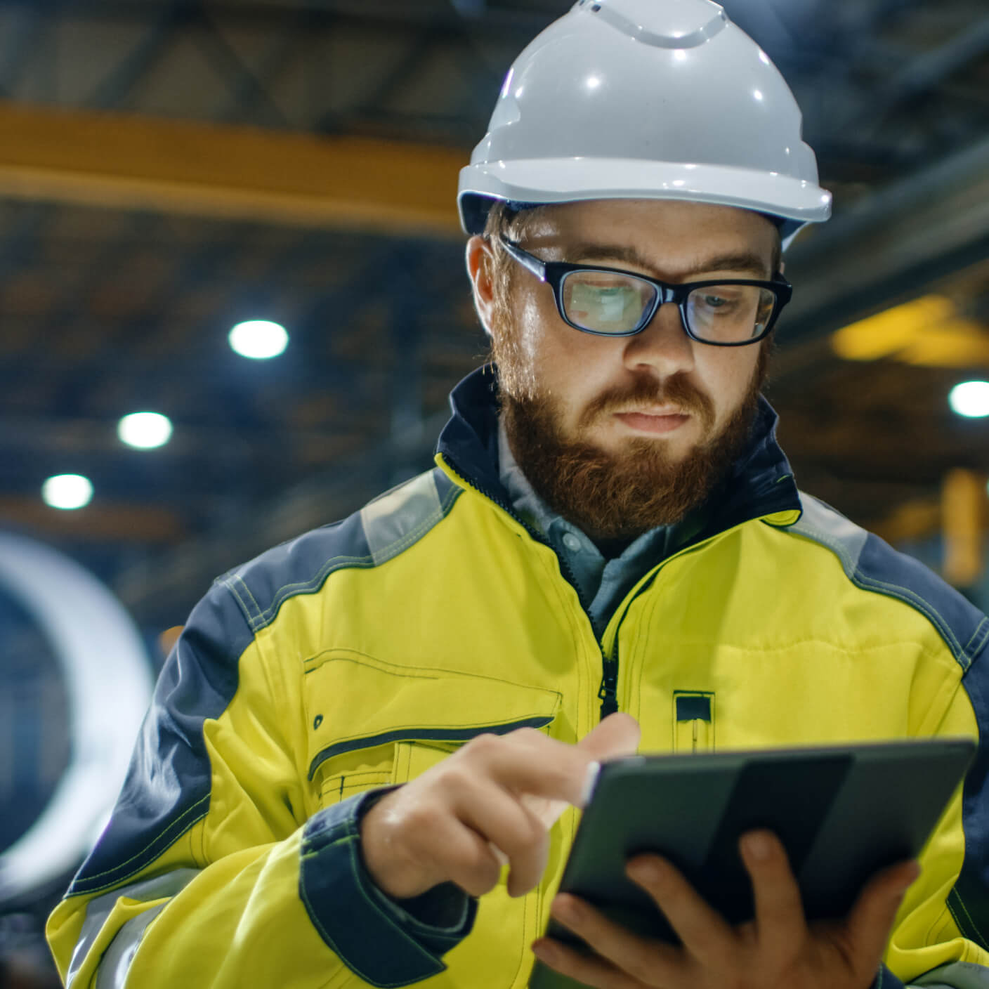 Engineer in a hardhat using an ipad