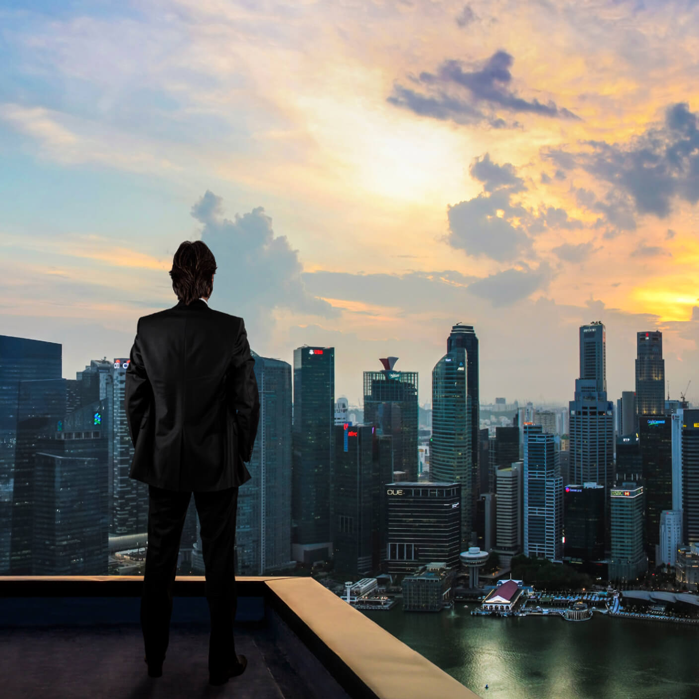 Man Standing On Top Of Office Building Dreaming