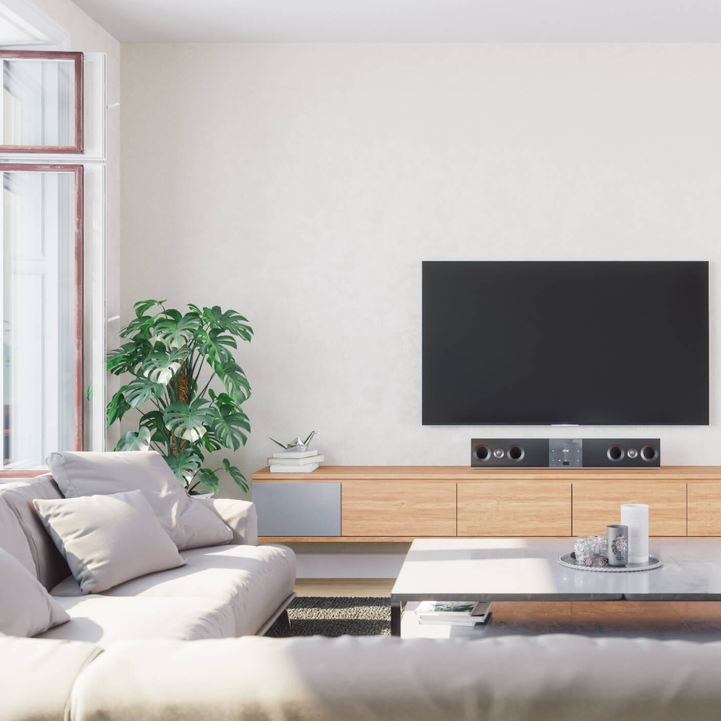 living room with a television and speaker set